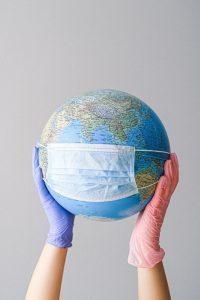 Globe wearing a Face Mask.